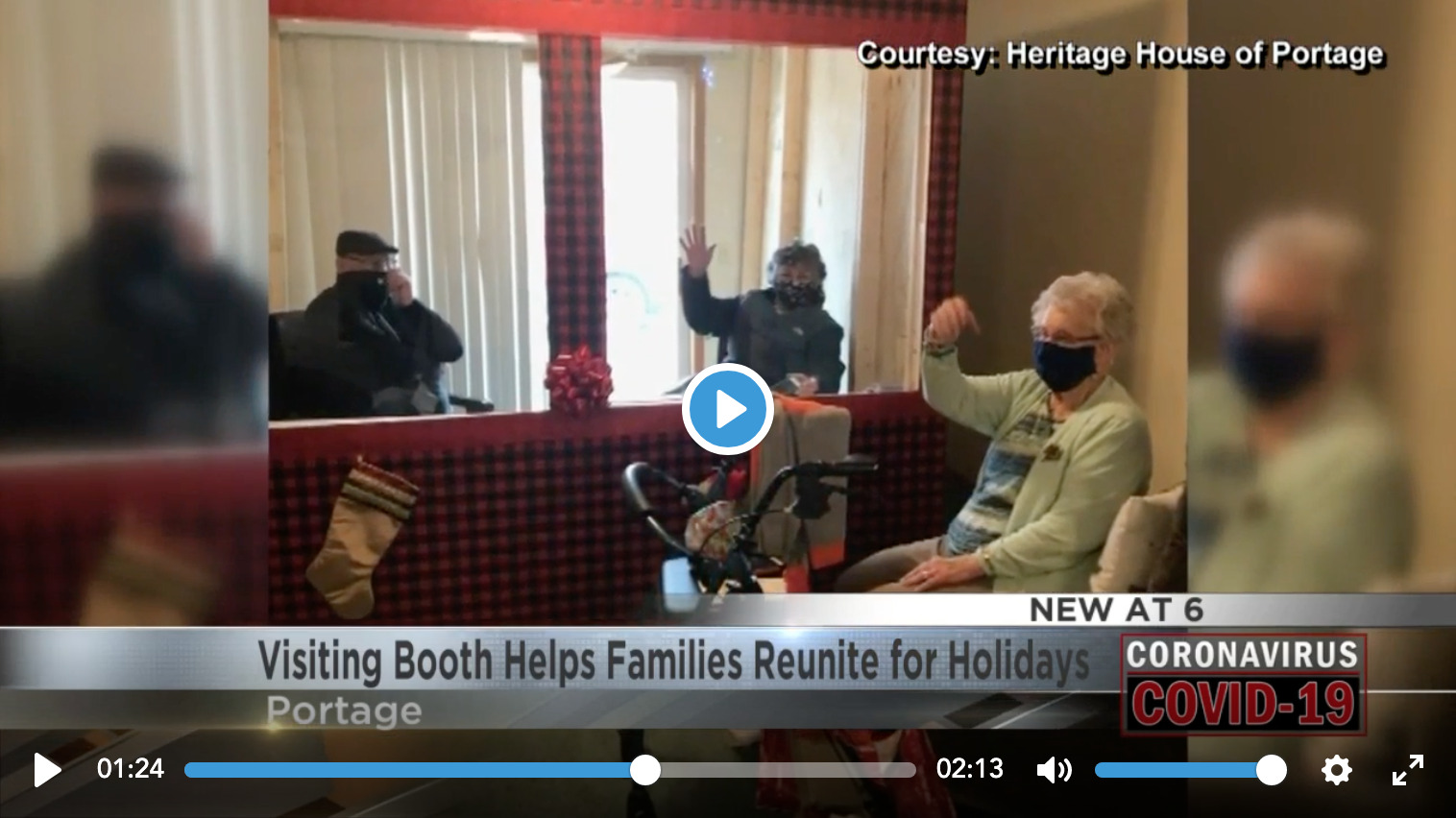 Video thumbnail of Senior resident visiting with a family members who are sitting in the Visiting Booth